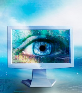 Eye on Flat Panel Monitor, Image by © Royalty-Free/Corbis