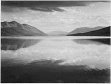 220px-Looking_across_lake_toward_mountains,_-Evening,_McDonald_Lake,_Glacier_National_Park,-_Montana.,_1933_-_1942_-_Ansel Adams