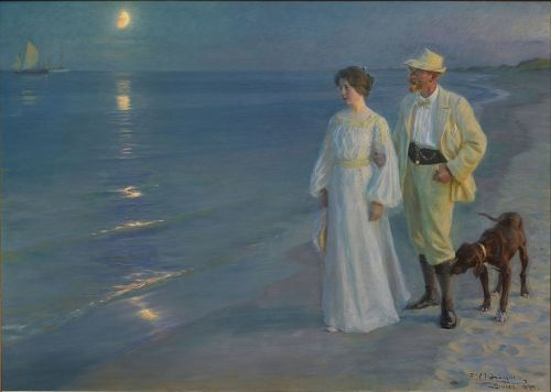 P.S. Krøyer, Summer Evening at Skagen Beach – The Artist and his Wife (1899) Via Wikimedia Commons